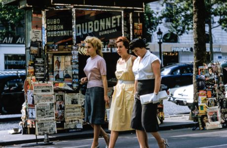 3 Women walking in front of a kiosk by Les Anderson on Unsplash